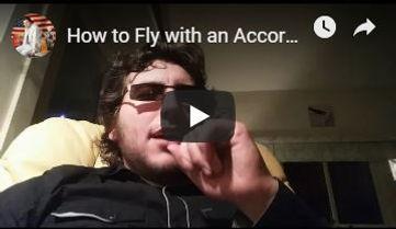 Cory - Flying With Accordion.JPG