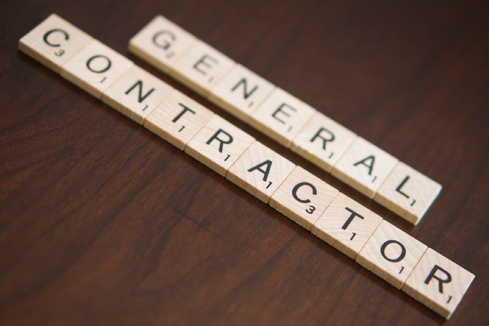Scrabble tiles used to form the word general contractor