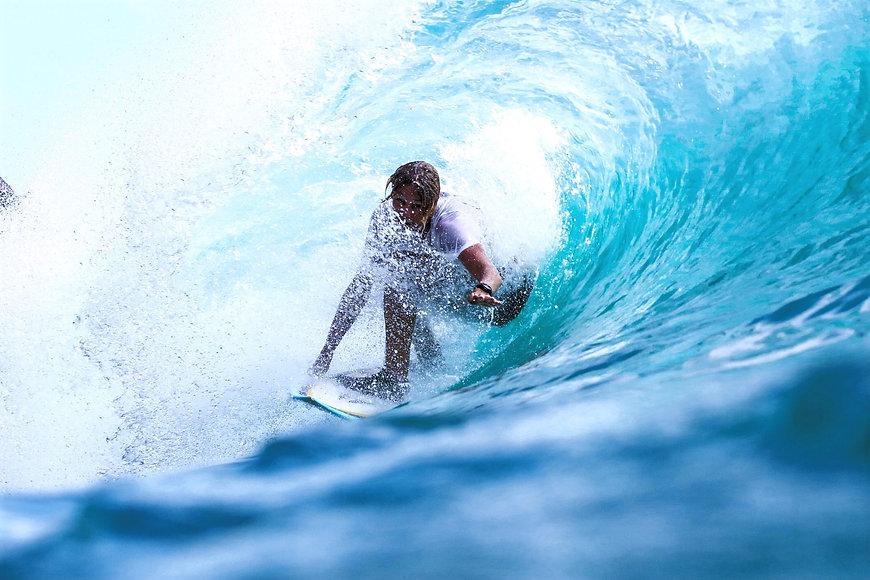 Surfing%20down%20a%20wave_edited.jpg