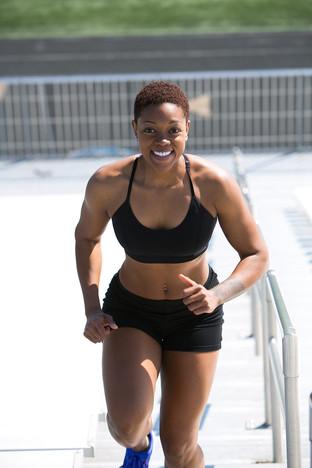 woman-wearing-black-sports-bra-and-jogge