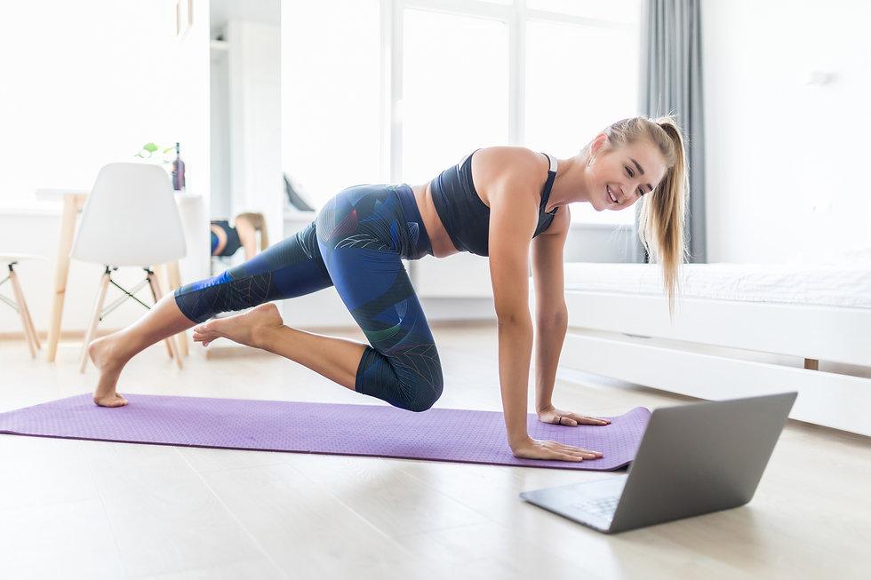 Attractive sportswoman doing push ups at