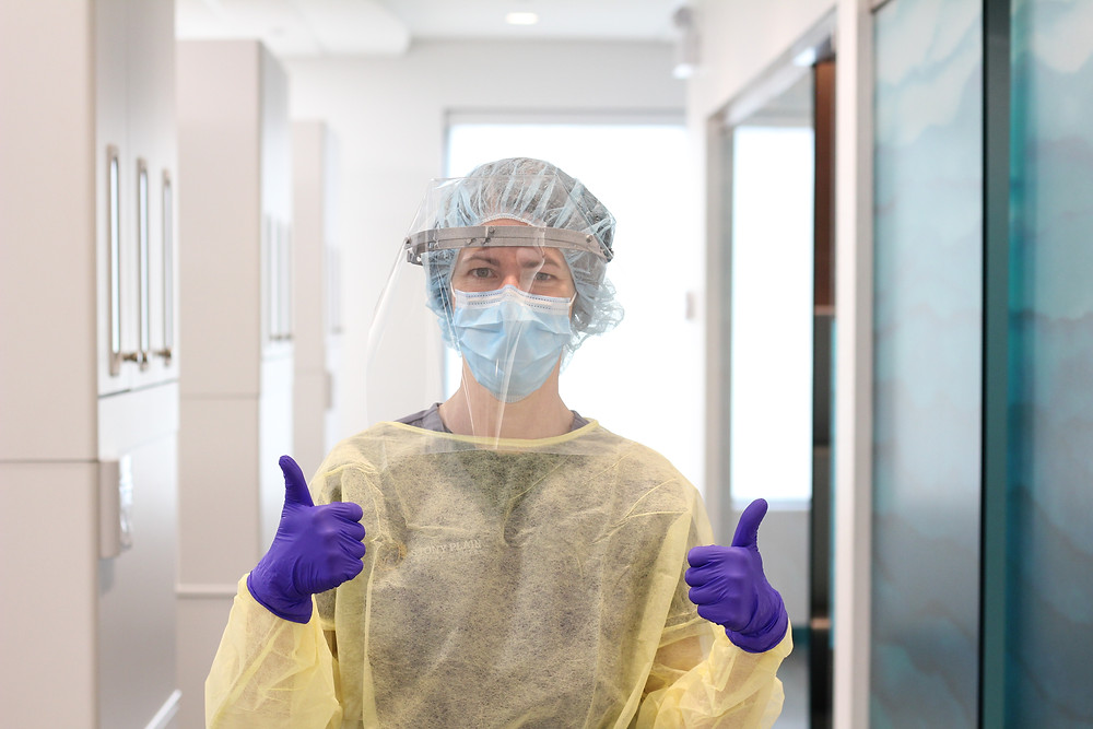 Robyn, a dental assistant, dresses in her full PPE