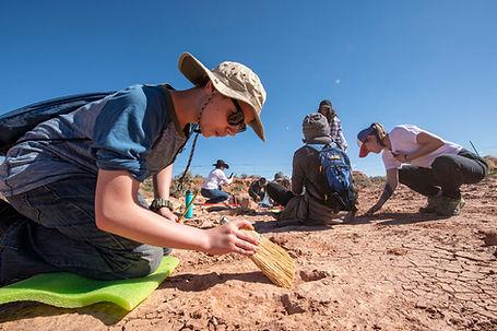 Cleaning Dino tracks near Moab, UT. Phot