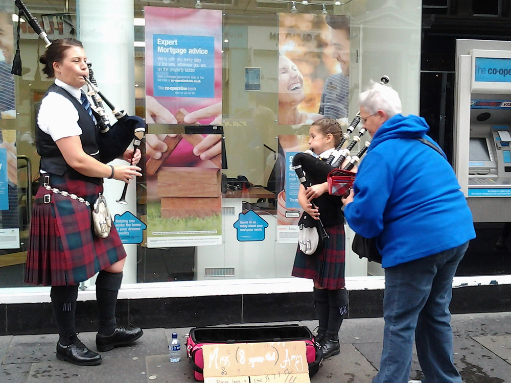 Lynne with pipers in the streets of Glasgow.jpg