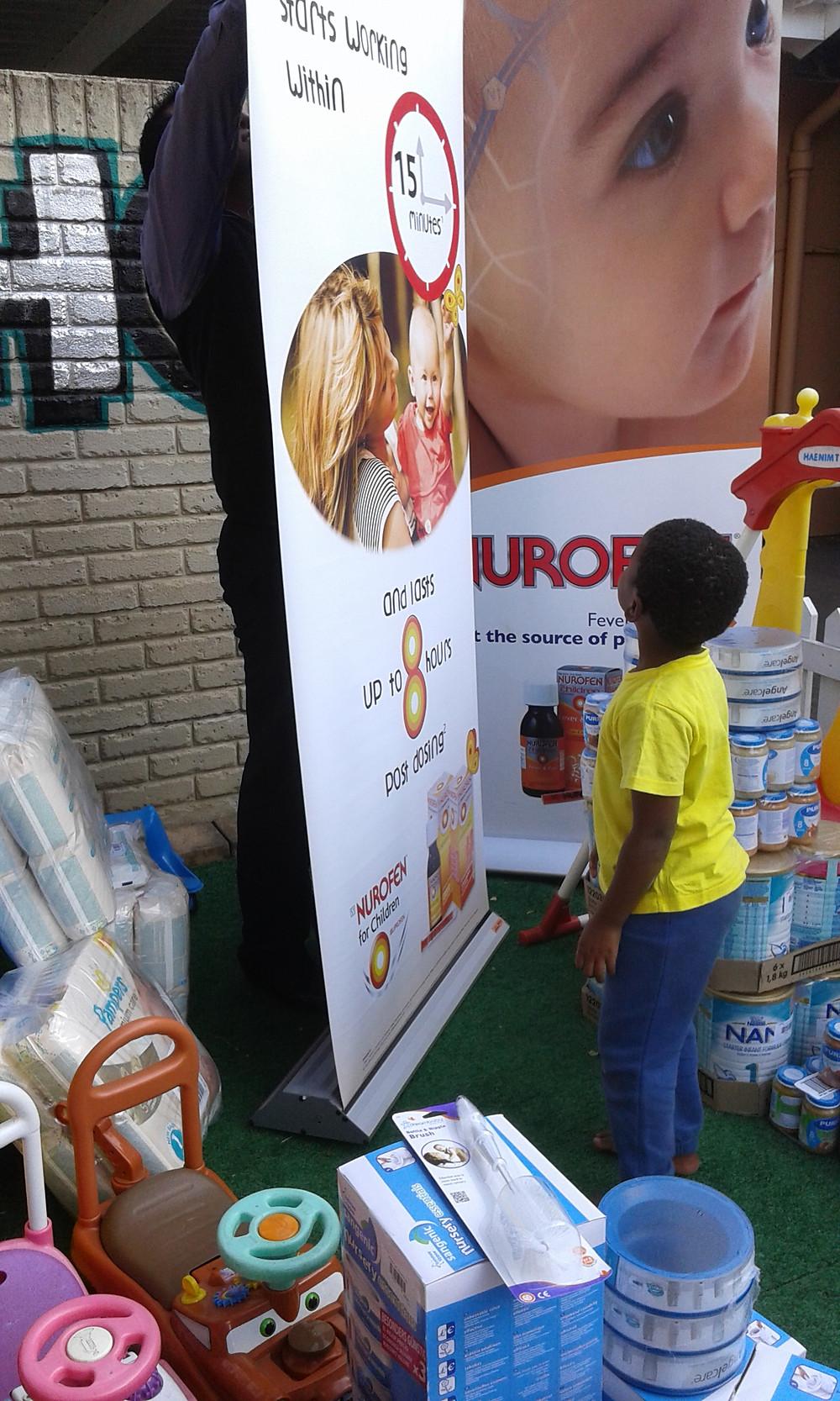 One of the children with donated items from Reckitt Benckiser.jpg