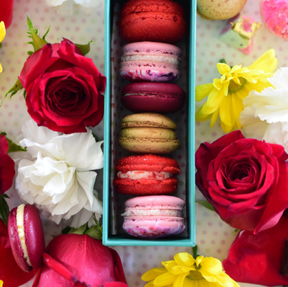 Box of Assorted Macarons: Flavors from Top-Bottom: Red Velvet, Berries & Cream, Passion Fruit, Mocha Caramel, Red Velvet, Berries & Cream