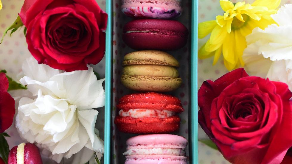 Macaron Gift Box surrounded by fresh flowers