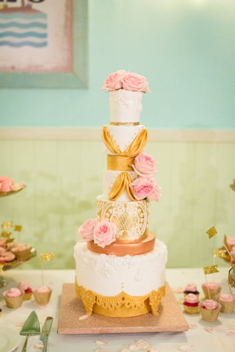 Eight Tier White & Gold Wedding Cake featuring Fresh Blush Peonies, Bas Relief and Royal Icing Stenciling