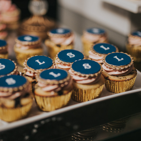 Cupcakes with blue and gold monogram