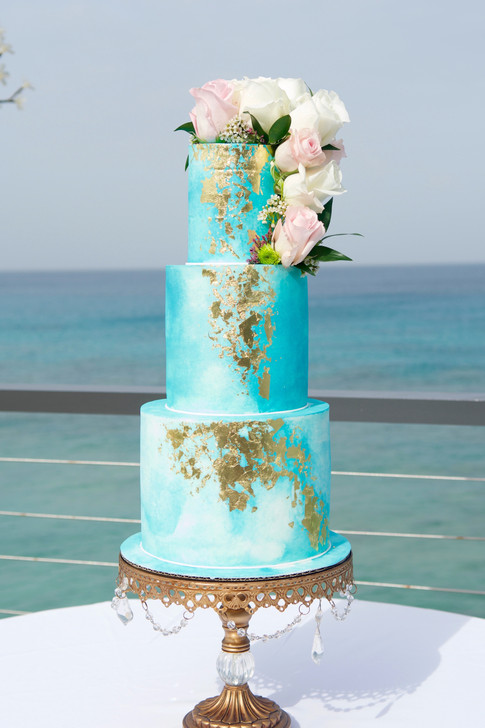 Three Tier Blue Watercolor Wedding Cake adorned with 24K Gold Leaf and Fresh Flowers