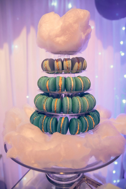 Macaron Tower of blue ombre macarons topped and surrounded with cotton candy (fairy floss)