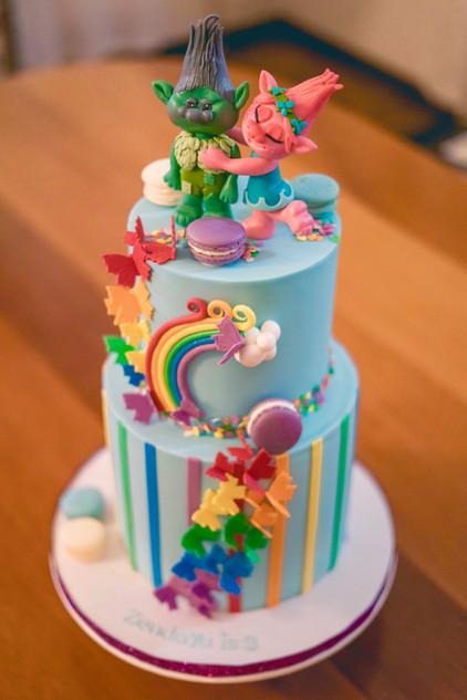 Two Tier Trolls Birthday Cake featuring Handmade Trolls Topper and cascade of Sugar Butterflies