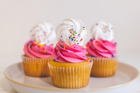 Birthday Cake Cupcakes topped with Sprinkled Baked Meringues