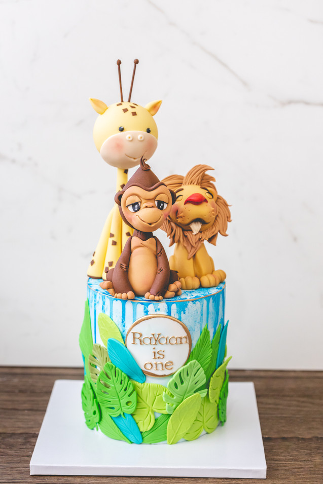 Jungle Themed Cake featuring Edible Monkey, Lion and Giraffe