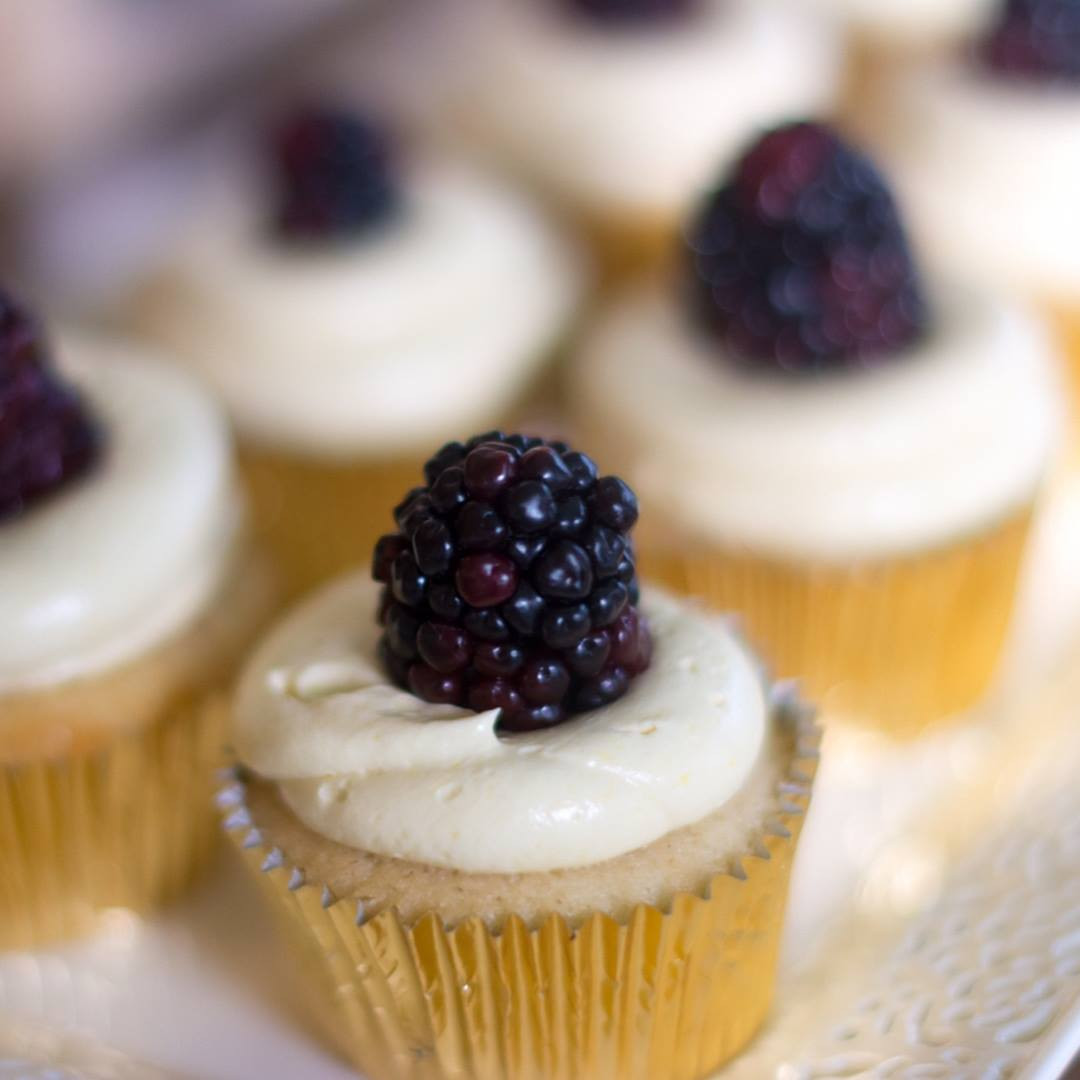 Spiced vanilla cupcakes topped with buttercream and blackberries