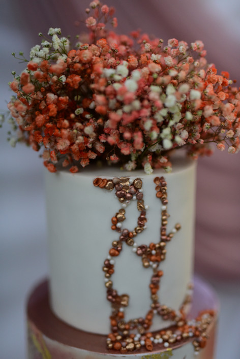Textural handmade sugar pearls on rose gold wedding cake