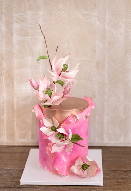 Gold and Pink birthday cake featuring sugar magnolias