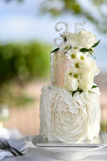 Two Tier Birthday Cake with silver leaf, sugar ruffles and cascading florals