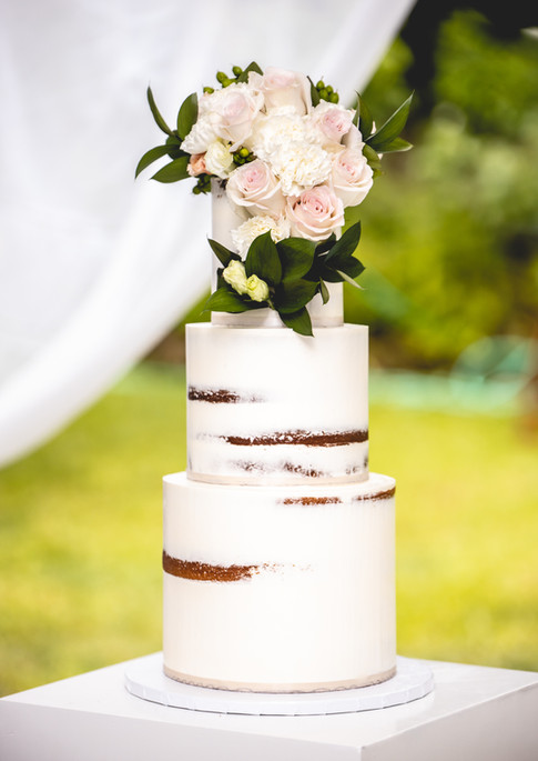 Three Tier Naked Wedding Cake featuring Fresh Florals and Foliage