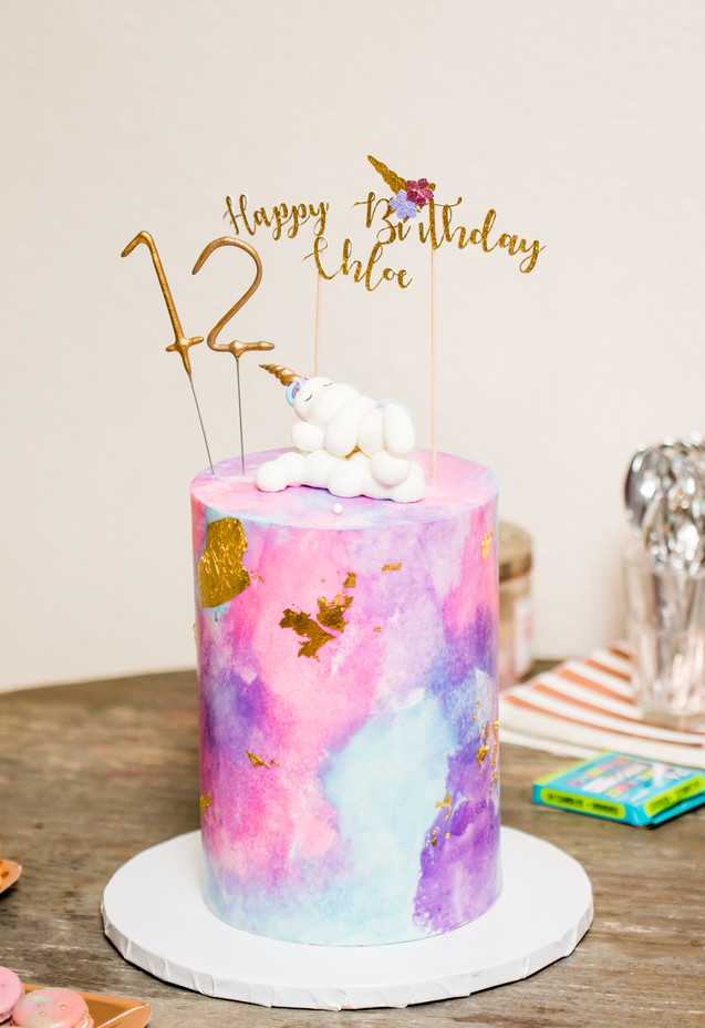 Unicorn Themed Birthday Cake featuring watercolor fondant design adorned with 24K gold leaf