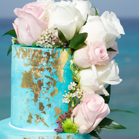 Blue watercolor wedding cake with fresh flowers