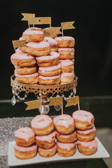 Delicious pink iced donuts embellished with 24K gold and glitter flags- Wedding Dessert Bar