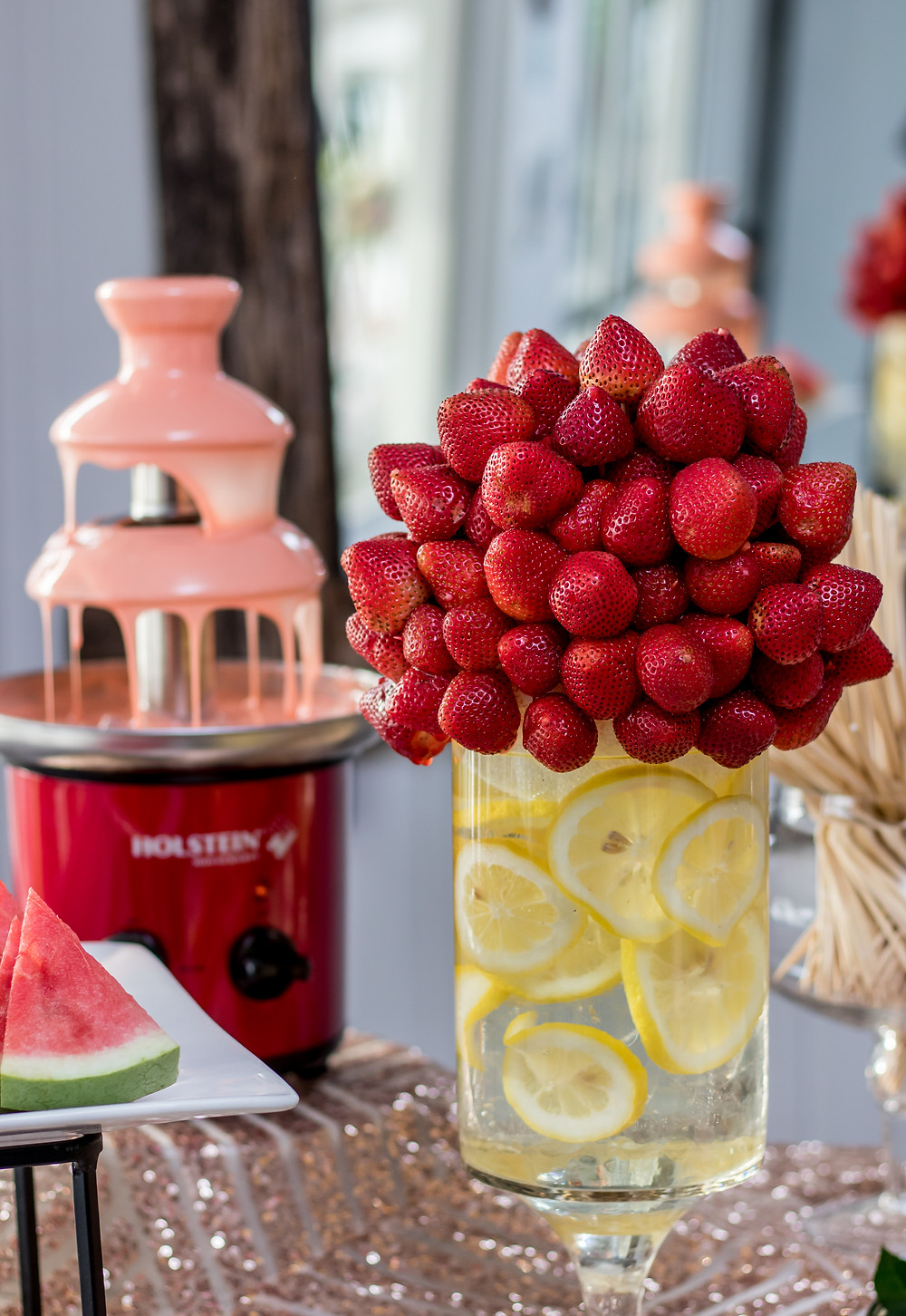 Chocolate fountain display featuring fresh strawberry vase