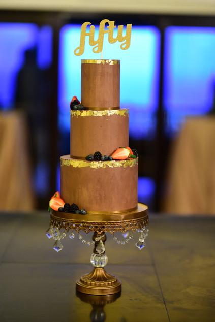 Three Tier Ganache Birthday Cake featuring fresh berries and 24K gold