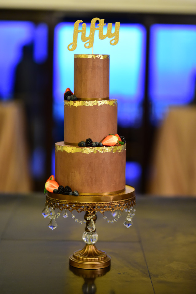 Three Tier Ganache Birthday Cake featuring fresh berries and 24K gold