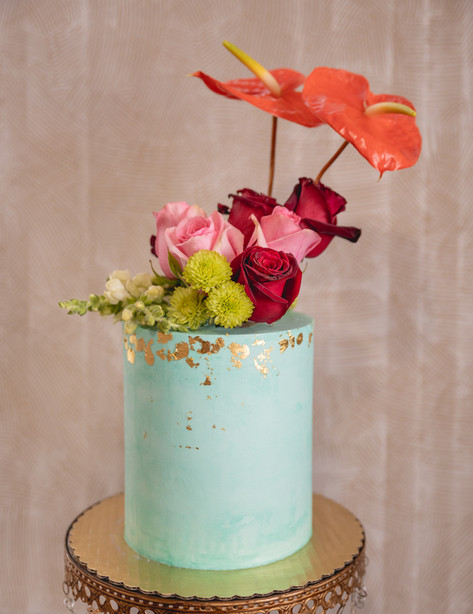 Teal Buttercream Cake Gilded in Gold and topped with Fresh Florals