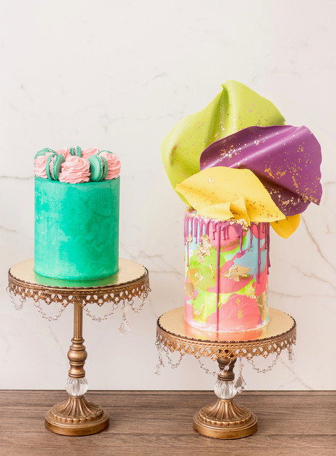 Buttercream cakes featuring watercolor design, chocolate sails and macarons