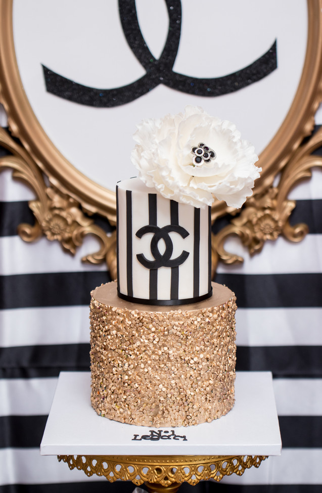 Two Tier COCO Chanel Birthday Cake featuring gold sequins and white gumpaste peony
