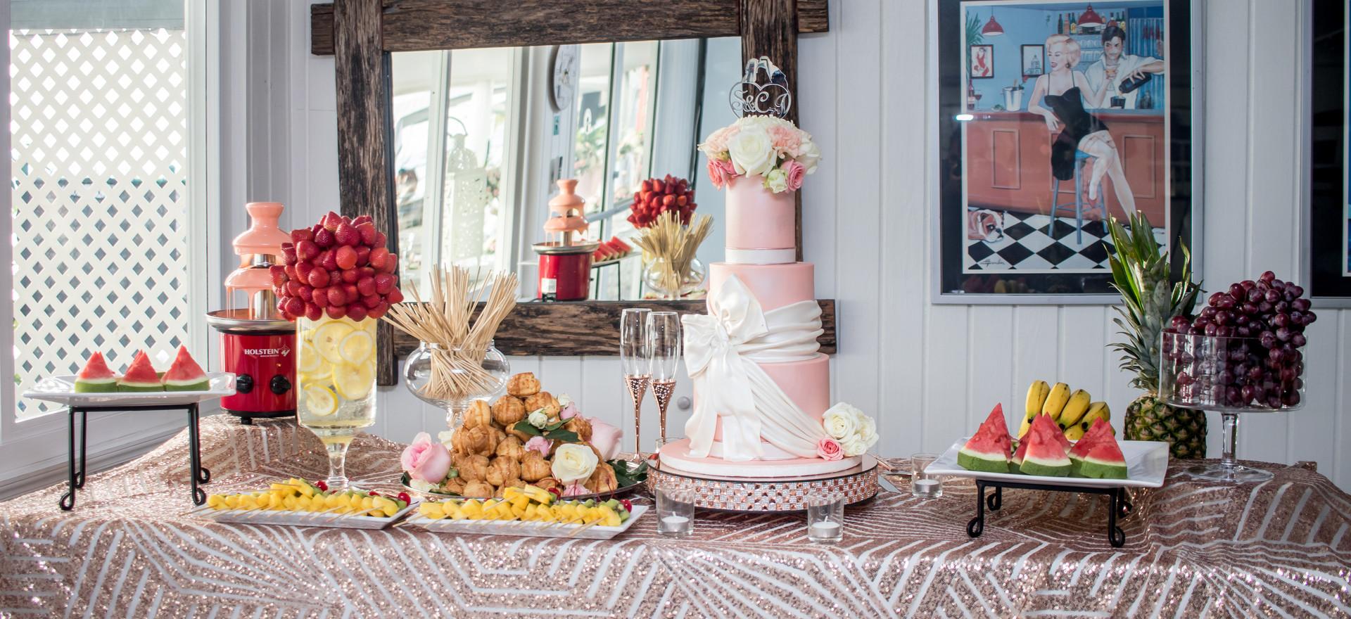Wedding Bar featuring Three Tier Wedding Cake, Fresh Fruits and Chocolate Fountain.