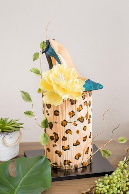 Cheetah print birthday cake featuring peony and sugar heel