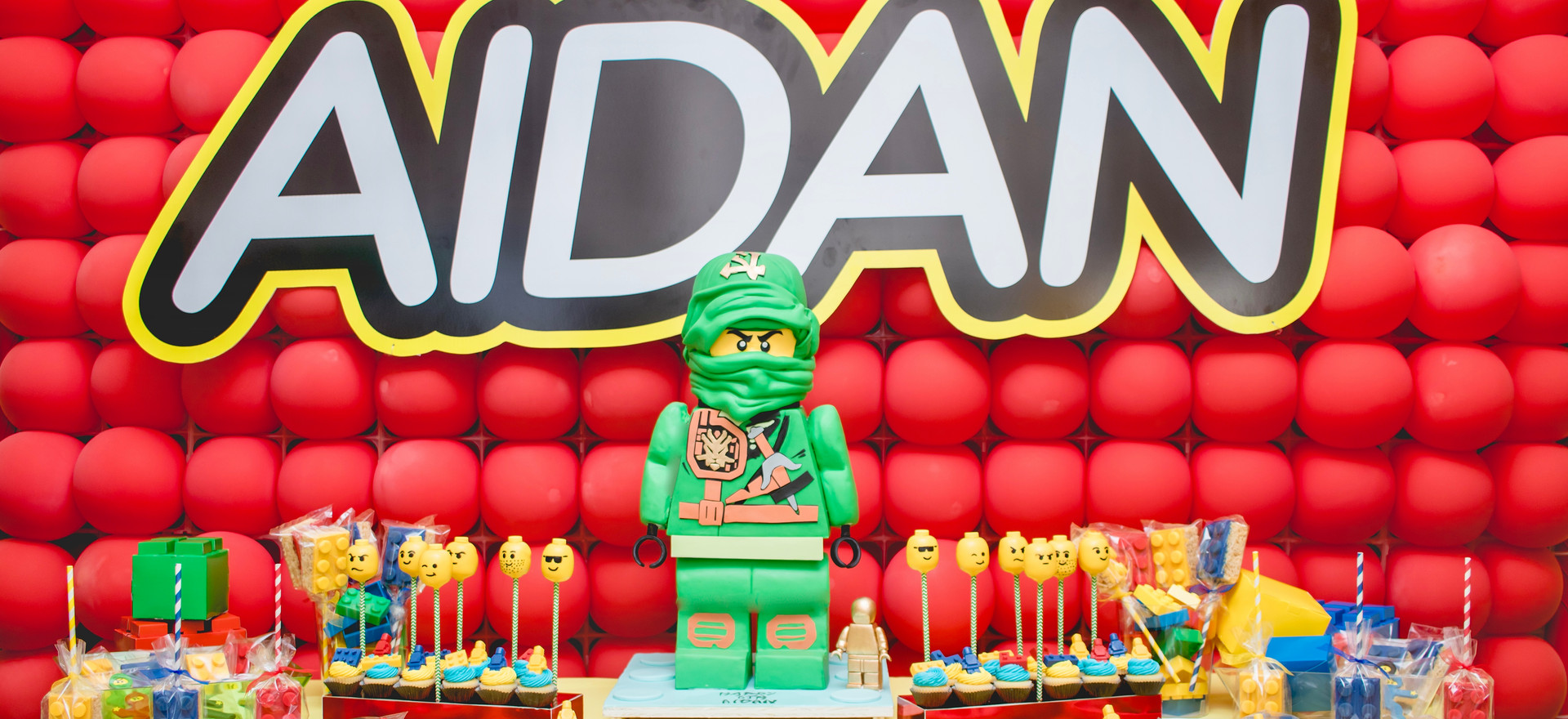 """""""Ninjago"""" Themed Dessert Bar featuring our standing 'ninjago' cake. Kindly note that treats pictured were not made by With Love By Esther James."""