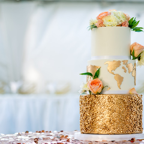 Three tier gold and white wedding cake