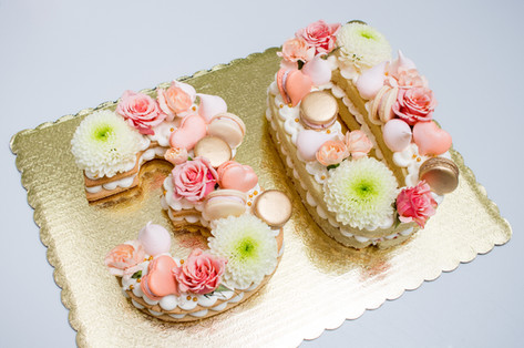Number 30 birthday cookie/cake duo topped with buttercream, florals, macarons and meringue kisses
