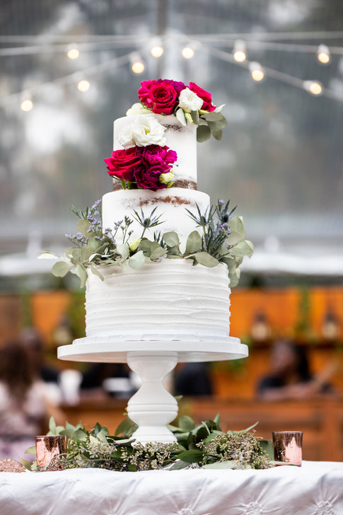 Three Tier Vegan Wedding Cake featuring Naked Top Tiers and Textured Base Tier with Fresh Florals and Fresh Eucalyptus
