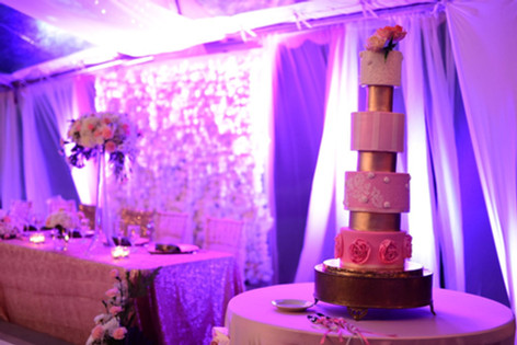 Seven Tier Wedding Cake featuring Pink Ombre Tones and Sugar Flower Arrangement