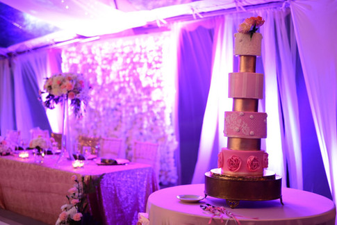 Seven Tier Wedding Cake featuring Pink Ombre Tones and Sugar Flower Arrangement