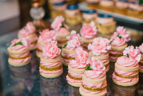 Tender sugar cookies built into mini cookie stacks. Topped with non-toxic flowers and embellished with gold glitter.