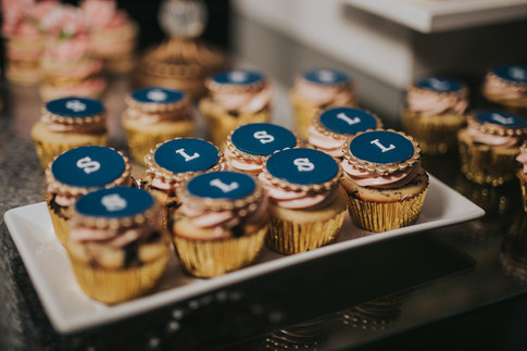 Wedding cupcakes styled with navy and gold edible discs