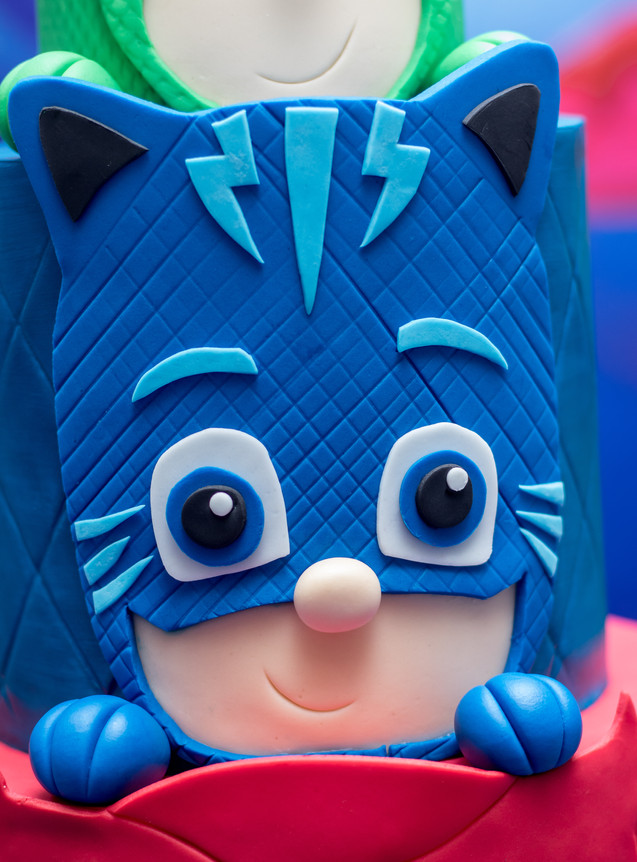Closeup of 'Cat boy' on Three Tier PJ Masks Birthday Cake