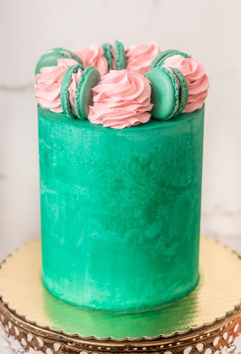 Teal Buttercream Cake featuring Blush Buttercream Swirls and Teal Macarons