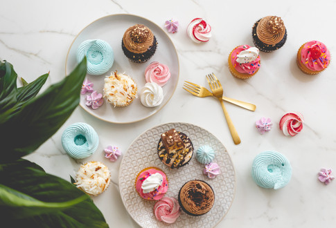 Plates filled with Assorted Cupcakes and Baked Meringues