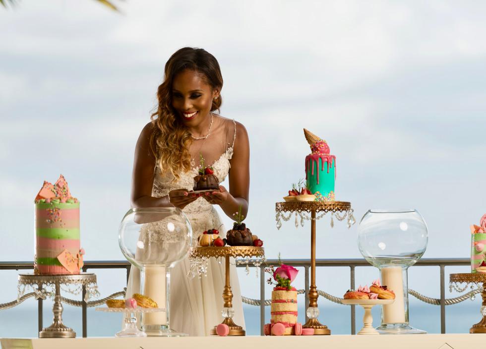 Gorgeous display of buttercream cakes, tartlets, mini bundt cakes, donuts and macarons- Wedding Dessert Bar