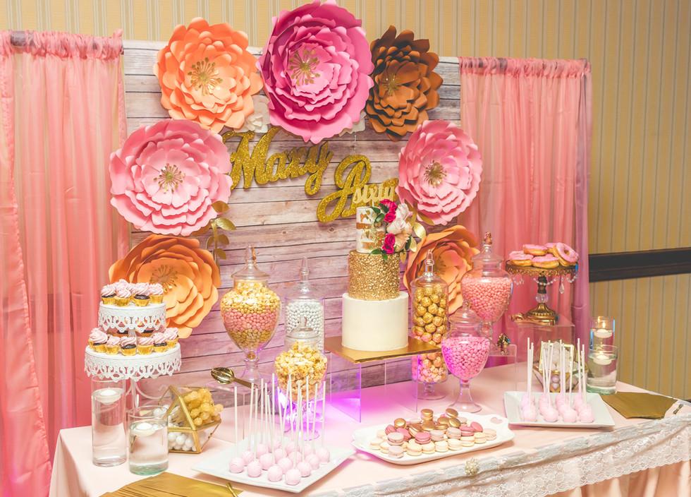 60th Birthday Celebration complete with dessert bar of three tier birthday cake, cake pops, mini cupcakes, mini donuts, macarons and assorted candies