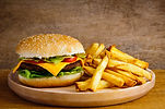 Fast food hamburger and french fries on
