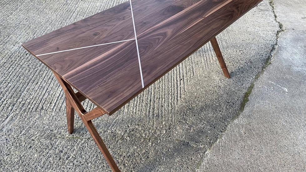 Modern classic walnut desk with brass inlay