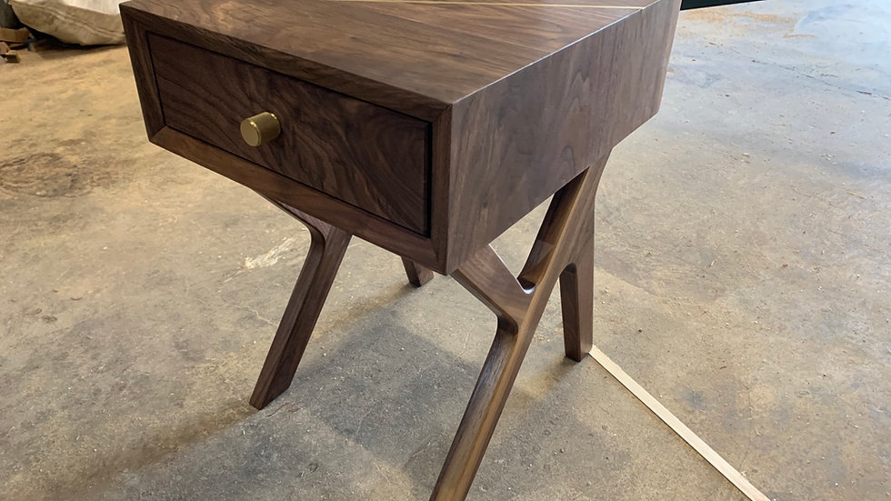 Walnut bedside table with brass inlay